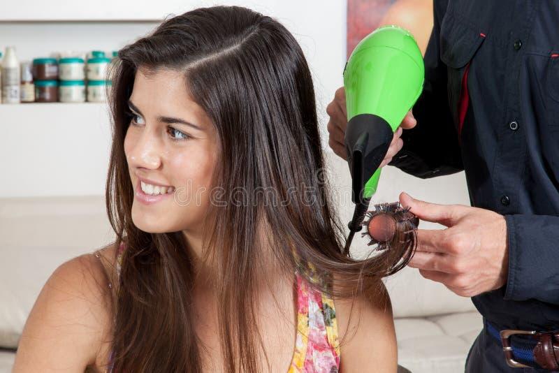 Fryzjerów drys włosiana jeden szczęśliwa kobieta obraz stock
