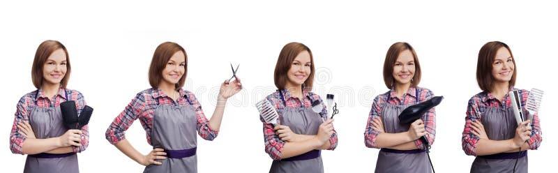Fryzjer trzyma różnorodnych fryzjerstw narzędzia na białym backgropund zdjęcia stock