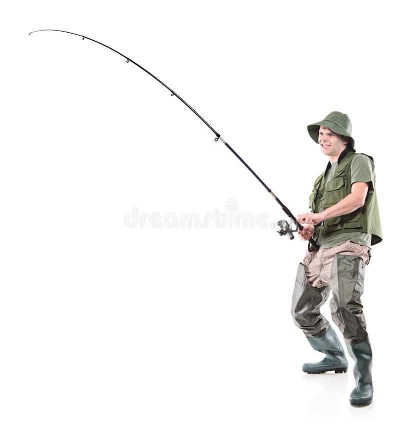 Fsherman holding a fishing pole. Full length portrait of a fisherman holding a fishing pole on white background royalty free stock images