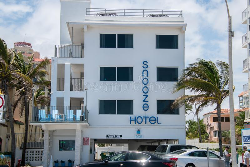 Ft. Lauderdale, Florida - May 6, 2019: Side view of the Snooze Hotel in Ft. Lauderdale Beach, Florida. The hotel is raised with royalty free stock images