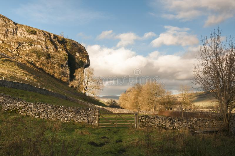 Kilnsey Crag. The 40 ft overhang of the 180 ft Kilnsey Crag in Upper Wharfedale, Yorkshire Dales village of Kilnsey, England. 24 November 2017 royalty free stock photography