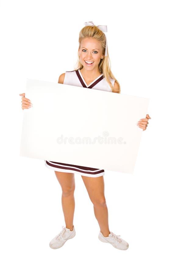 Fußball: Cheerleader Holding Blank Sign lizenzfreie stockbilder