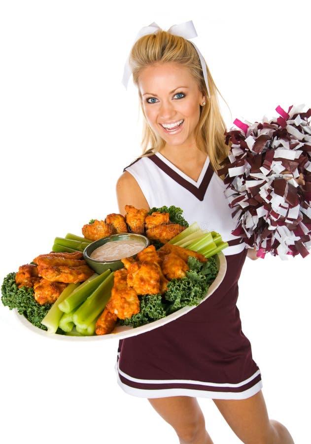 Fußball: Cheerleader Holding Tray Of Chicken Wings stockfoto