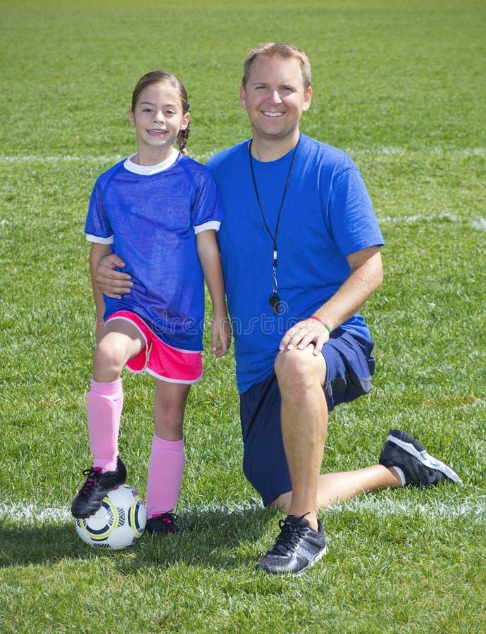 Fußball-Trainer- und Fußball-Spielerporträt stockbilder
