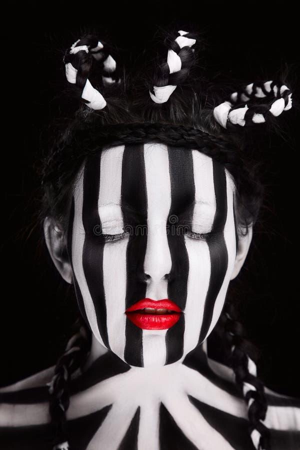 Fußballfan der jungen Frau mit Gesicht lizenzfreie stockfotografie
