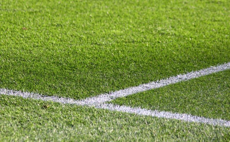 Fußballplatz des grünen Grases stockfotografie