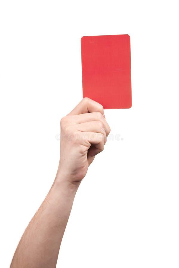 Fußballreferenthand, die rote Karte hält stockbilder