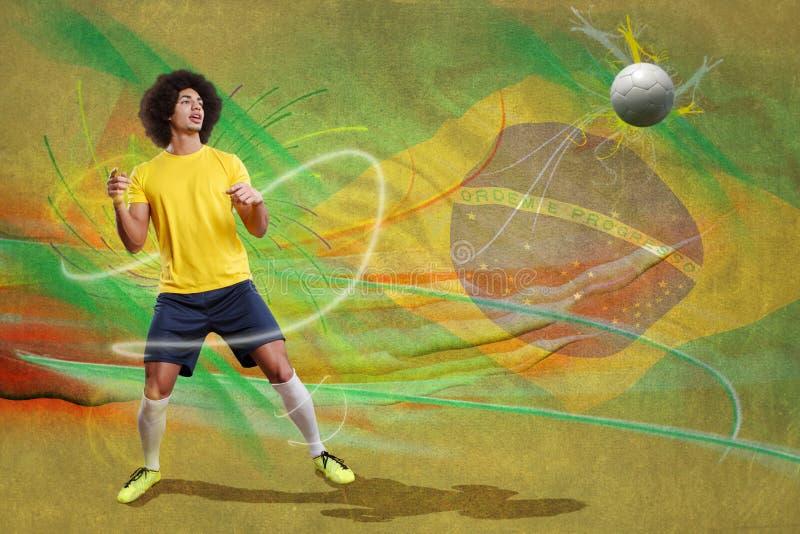 Fußballspieler mit Kugel stockbild