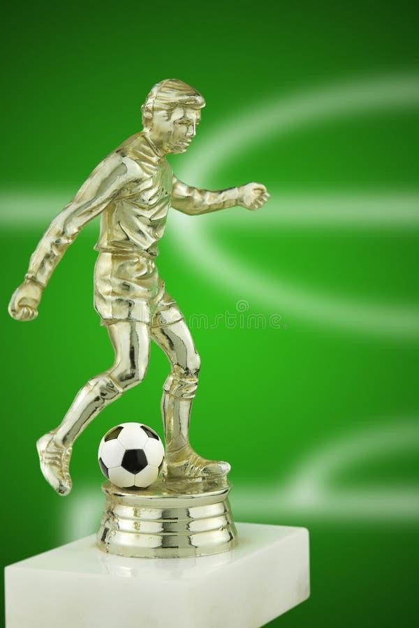Fußballspielertrophäe lizenzfreies stockbild