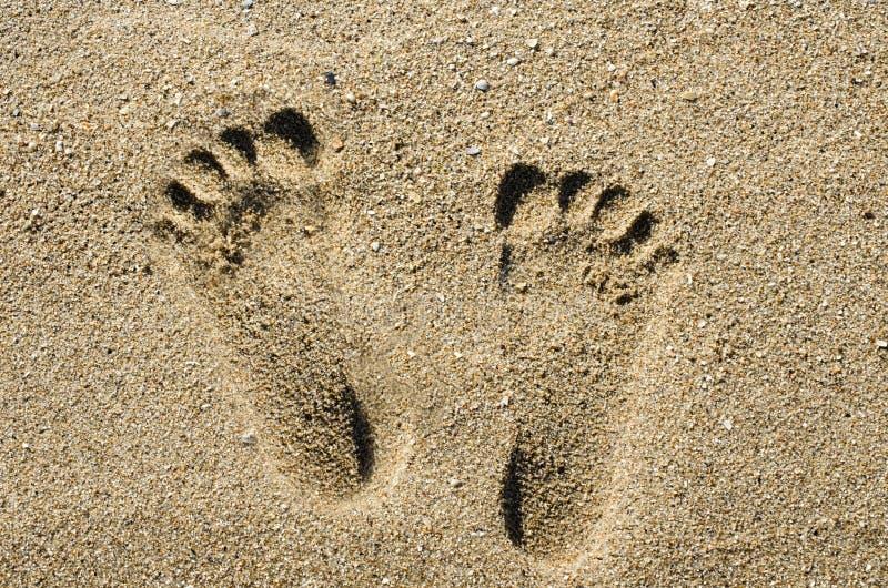 Fußschritt auf Sandstrand-Hintergrundbeschaffenheit lizenzfreie stockfotografie