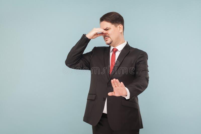 Fu, ele ` s muito fedido ele desgosto do ` s Cheiro mau foto de stock royalty free