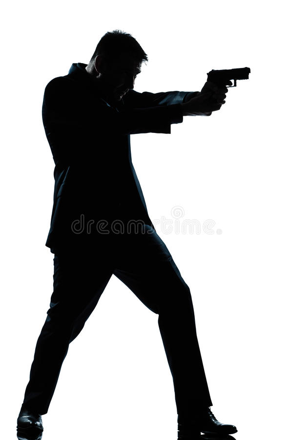 Fucilazione integrale dell'uomo della siluetta con la pistola immagine stock libera da diritti