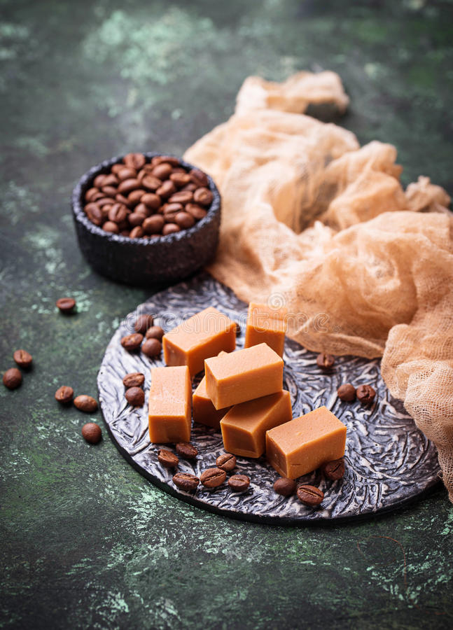 Fudge toffee candy with coffee beans. Selective focus royalty free stock image