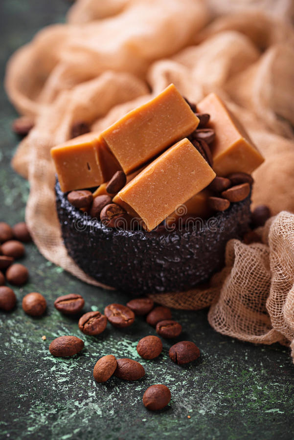 Fudge toffee candy with coffee beans. Selective focus stock photo