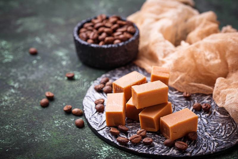 Fudge toffee candy with coffee beans. Selective focus royalty free stock photography