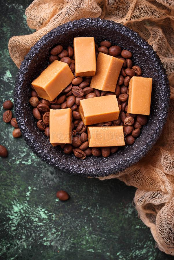 Fudge toffee candy with coffee beans. Selective focus royalty free stock photo