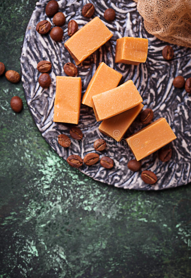 Fudge toffee candy with coffee beans. Selective focus royalty free stock images