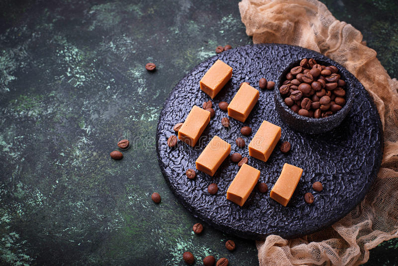 Fudge toffee candy with coffee beans. Selective focus stock images