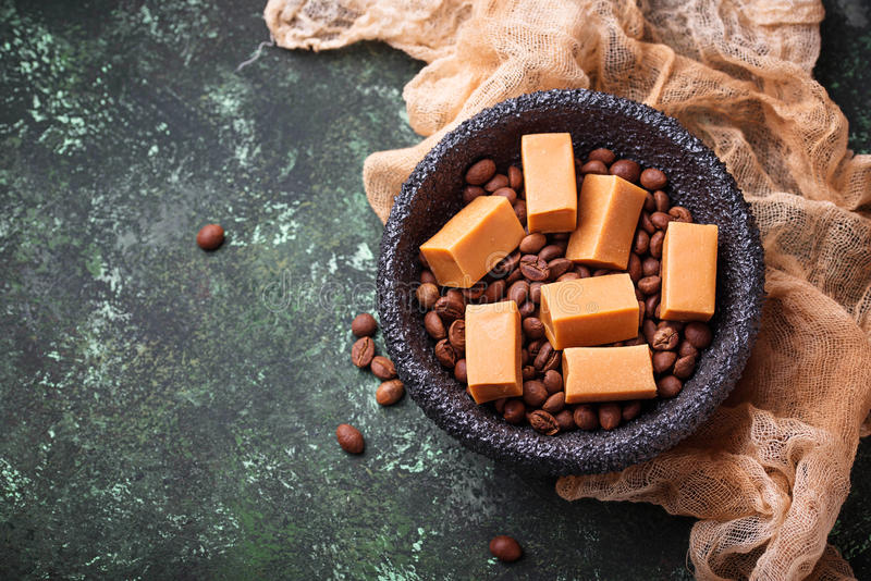 Fudge toffee candy with coffee beans. Selective focus stock photos