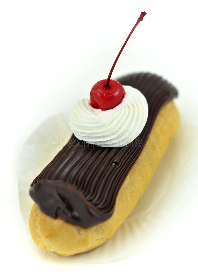 Fudge Topped Eclair Dessert Pastry with Cherry stock photography