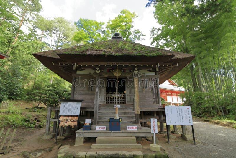 Fudoudo au hall de Bisyamon de caverne de Takkou, Hiraizumi photo libre de droits