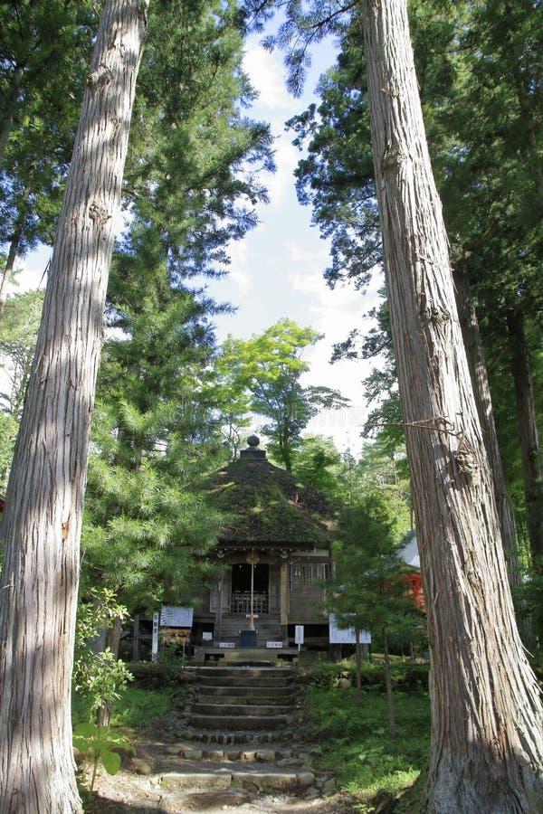 Fudoudo au hall de Bisyamon de caverne de Takkou, Hiraizumi photographie stock libre de droits