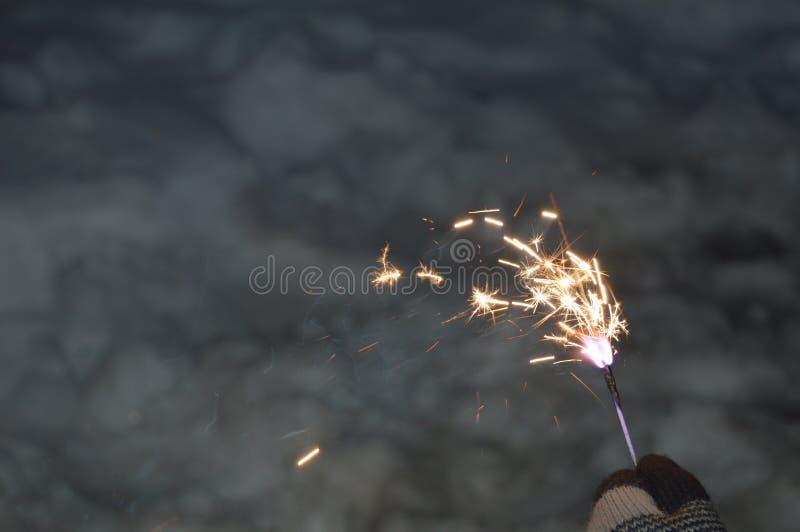 Fuego de Bengala en mano con guantes fotos de archivo libres de regalías