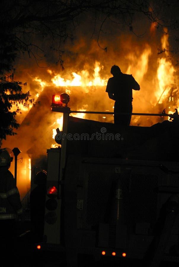 Fuego de la casa imagen de archivo