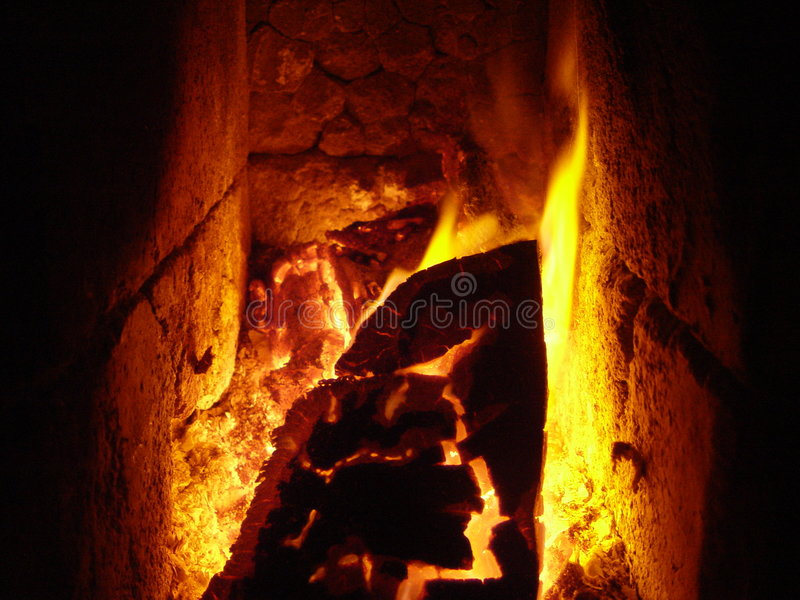 Fuego de la estufa imagen de archivo