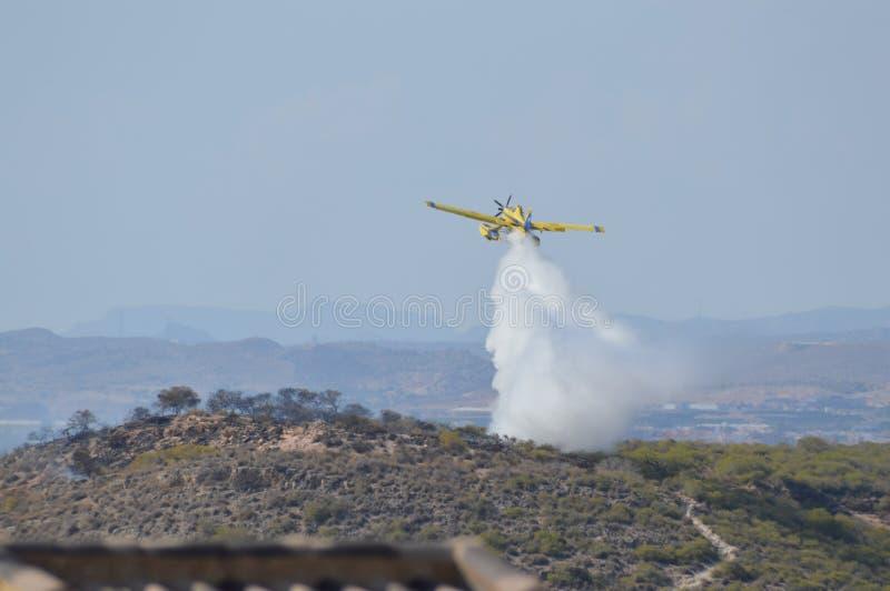 Fuego del arbusto de los aviones que lucha fotos de archivo libres de regalías