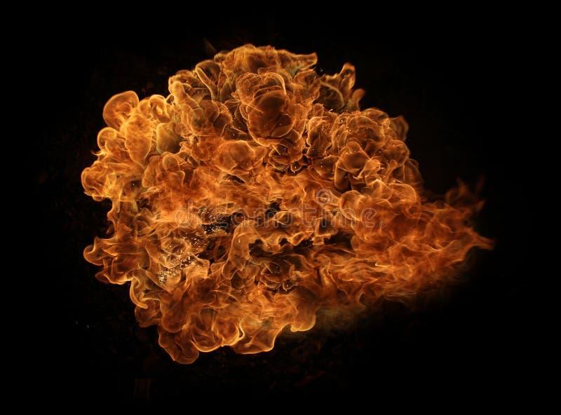 Fuego y llamas con una obscuridad ardiente - rojo - fondo anaranjado Fuego y llamas fotos de archivo libres de regalías