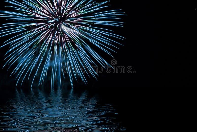 Fuegos artificiales en azul imagen de archivo