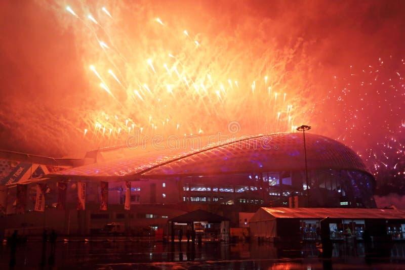 Fuegos artificiales sobre el estadio Fisht imagen de archivo