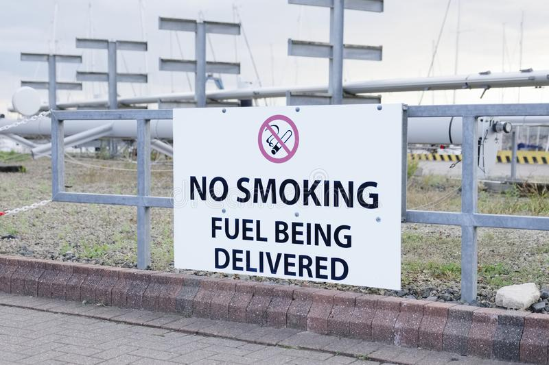 Fuel being delivered no smoking sign at oil and gas refinery stock image