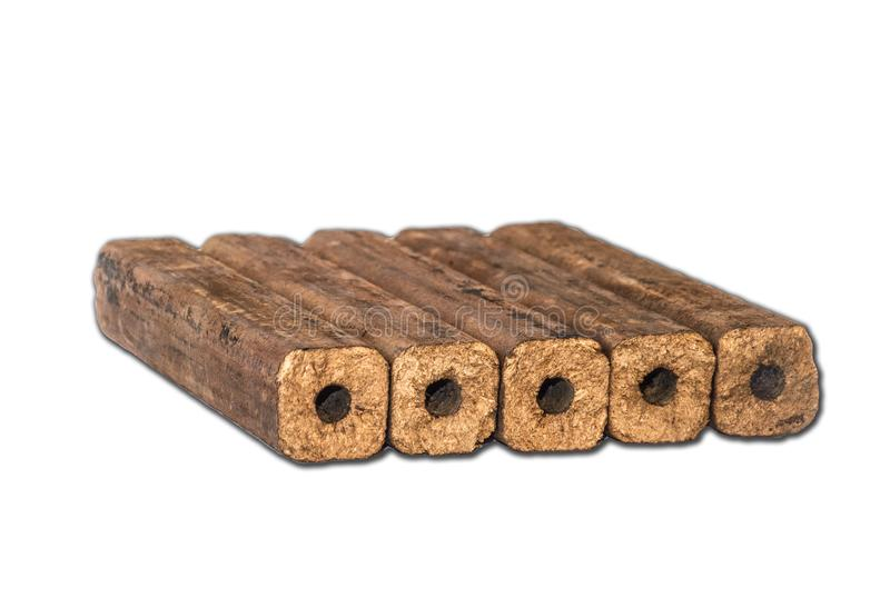 Fuel briquettes folded in rows on a white background. Wooden  briquettes are an environmentally friendly fuel source that are used to start a fire. They are stock photos