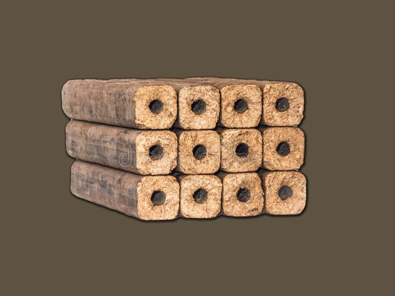 Fuel briquettes folded in rows on a white background. Wooden  briquettes are an environmentally friendly fuel source that are used to start a fire. They are royalty free stock photos