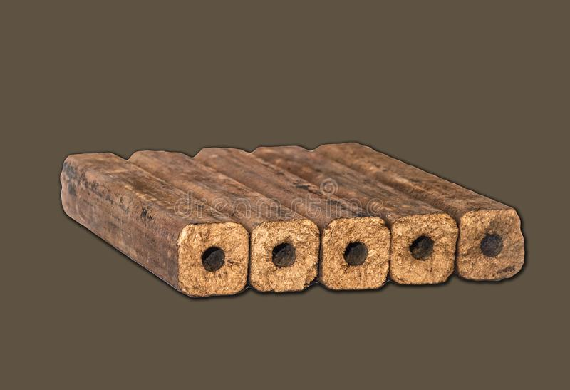 Fuel briquettes folded in rows on a white background. Wooden  briquettes are an environmentally friendly fuel source that are used to start a fire. They are royalty free stock images