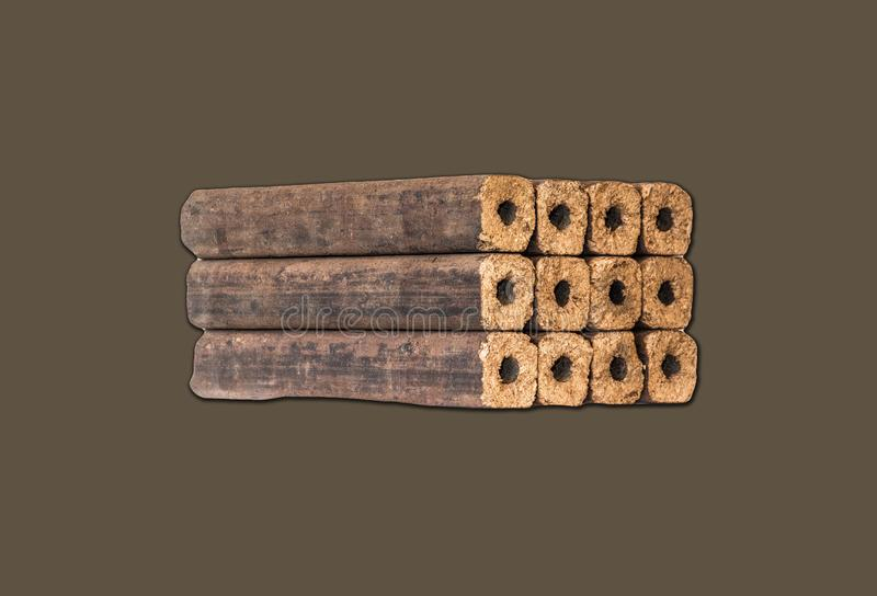 Fuel briquettes folded in rows on a white background. Wooden  briquettes are an environmentally friendly fuel source that are used to start a fire. They are stock image