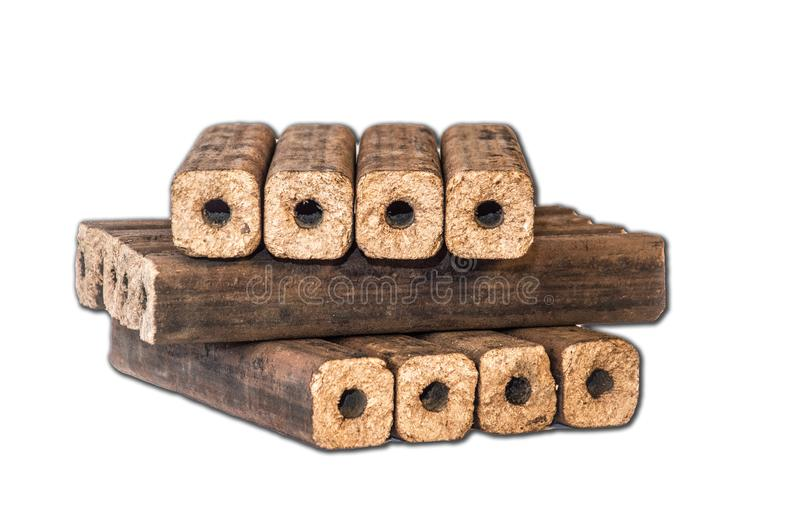 Fuel briquettes folded in rows on a white background. Wooden  briquettes are an environmentally friendly fuel source that are used to start a fire. They are royalty free stock photo