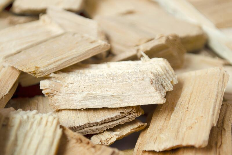 Fuel chips for smoking or heating. Close-up of wood fuel chips, wood chips. Background of small pieces of wood chips for. Fuel chips for smoking or heating stock image