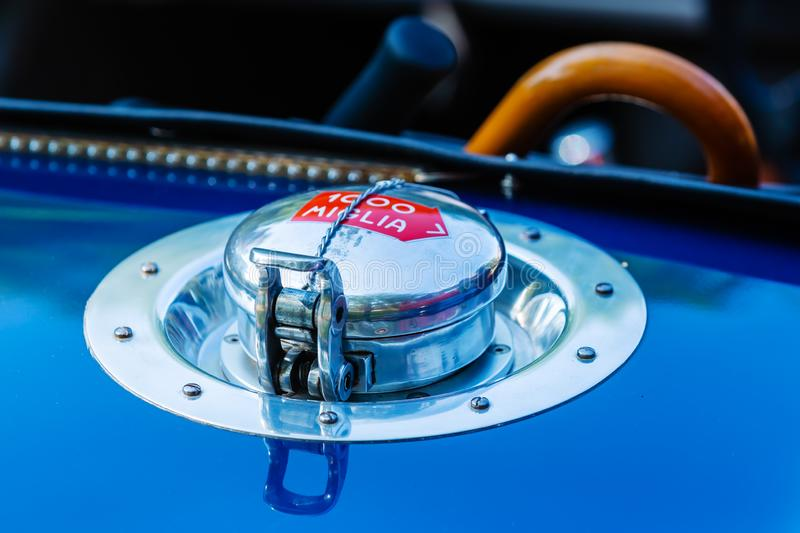 Fuel filler port of a historical car with a mille miglia label, a legendary car race. Picture of a fuel filler port of a historical car with a mille miglia label stock photography
