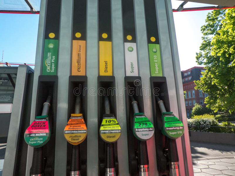 Fuel pump nozzles. Berlin, Germany - May 5, 2018: Fuel pump nozzles for different kinds of fuel in a filling station royalty free stock images