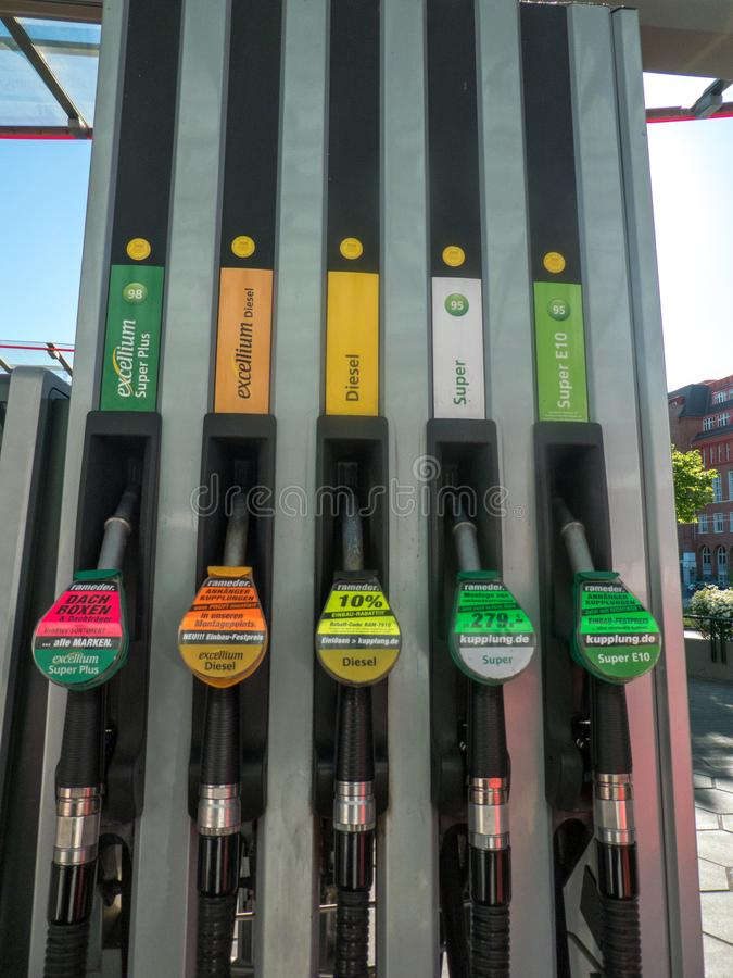 Fuel pump nozzles. Berlin, Germany - May 5, 2018: Fuel pump nozzles for different kinds of fuel in a filling station royalty free stock photography