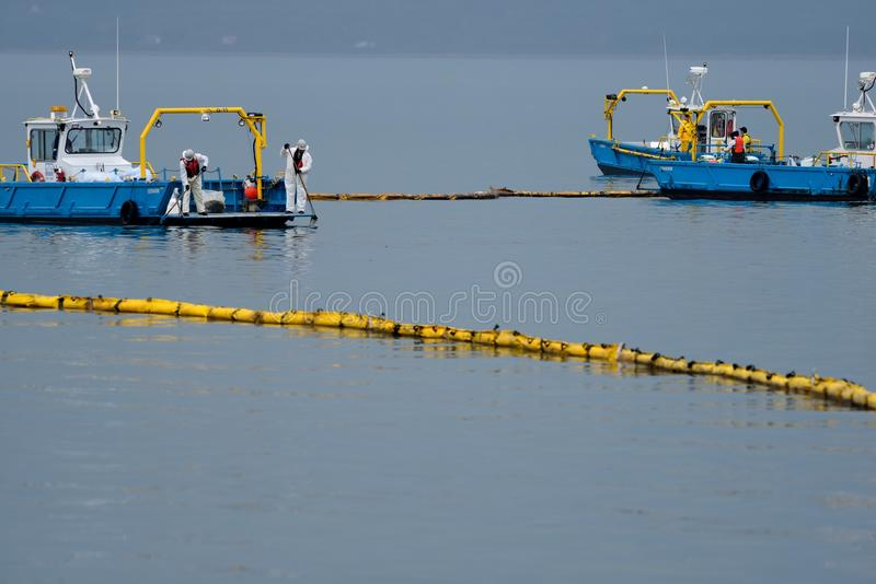 Fuel spill. Cleaning up a fuel spill stock image
