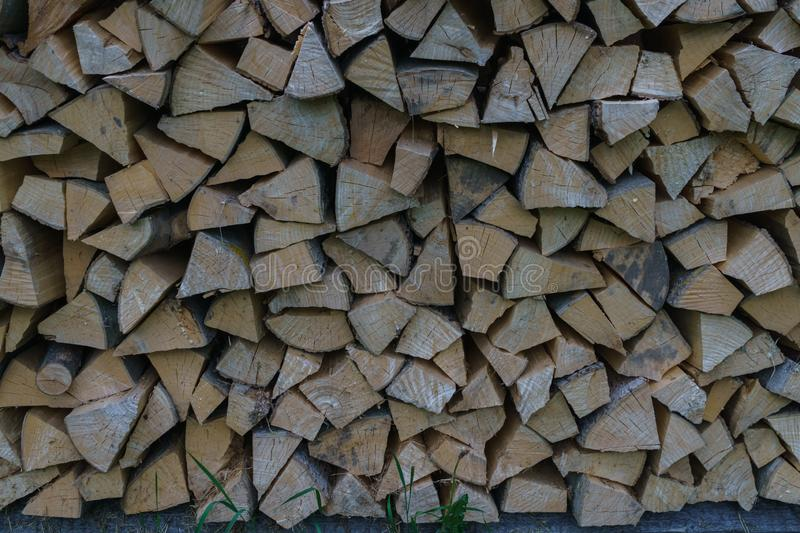Fuel for stove heating at home and bath. Rural life. Wooden firewood is laid in the walls. Natural wood royalty free stock photo