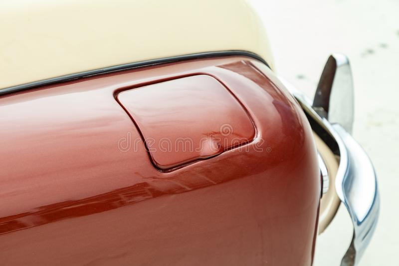 Fuel tank flap view of in brown and beige color after cleaning before sale in a sunny day on parking. Auto service royalty free stock images