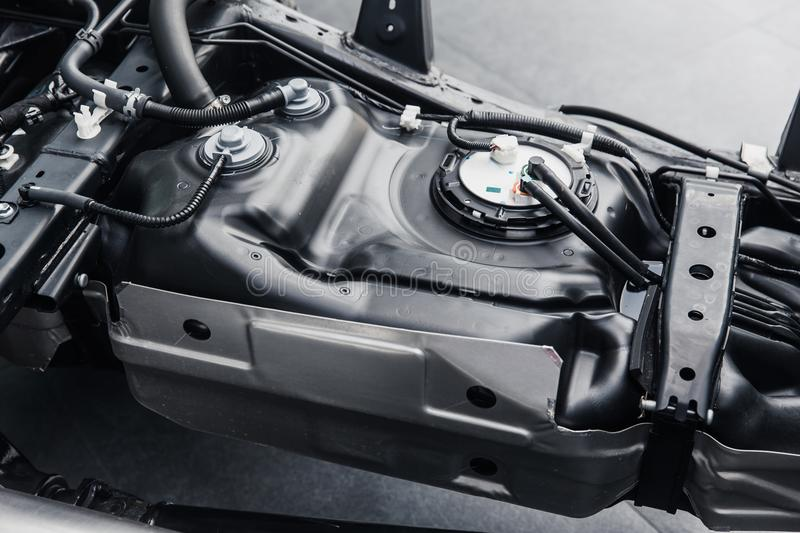 Fuel tank inside car chassis underbody stock photo