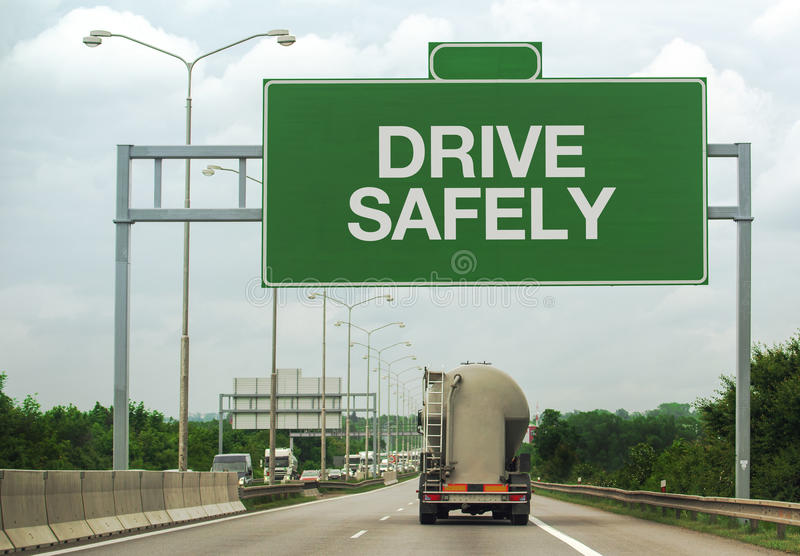 Fuel Tanker Truck and Drive Safely Sign stock photo