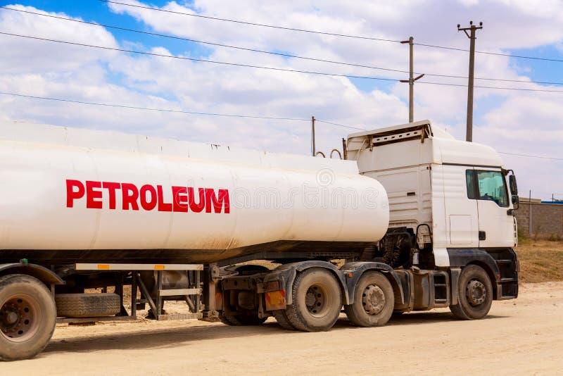 Fuel tanker truck gasoline transporter on the road. Fuel transportation concept stock photography