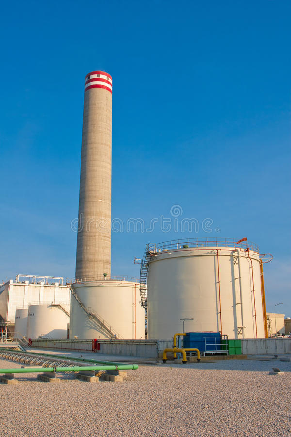 Download Fuel Back Up Tanks And Smokestack Royalty Free Stock Image - Image: 19901966